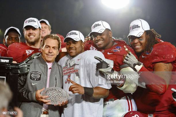 National Championship: Alabama coach Nick Saban and Mark Ingram victorious with AFCA The Coaches' Trophy after winning game vs Texas at Rose Bowl...