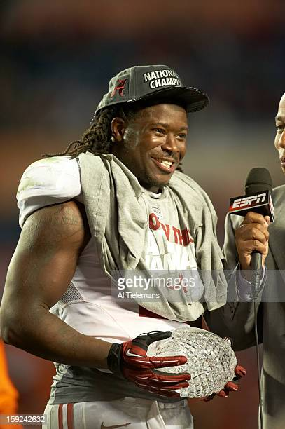 BCS National Championship Alabama Eddie Lacy victorious holding AFCA The Coaches' Trophy after winning game vs Notre Dame at Sun Life Stadium Miami...