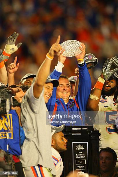 BCS National Championship Florida coach Urban Meyer victorious with trophy after winning game vs Oklahoma Miami FL 1/8/2009 CREDIT Damian Strohmeyer
