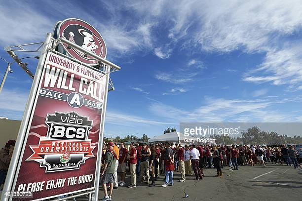 BCS National Championship View of fans in parking lot near will call sign for tickets before Florida State vs Auburn game at Rose Bowl Stadium...
