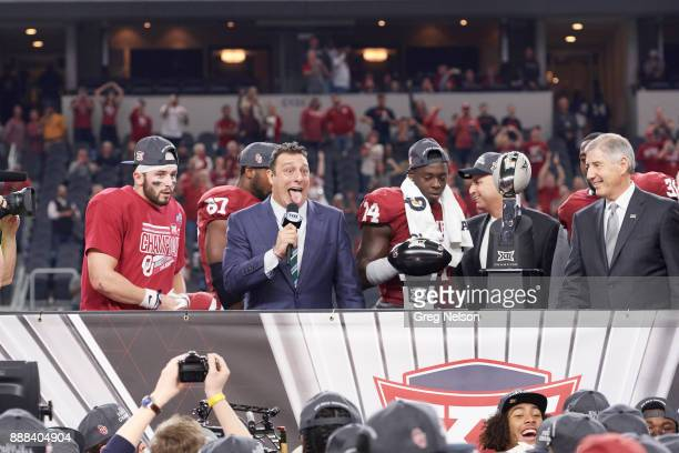 Big 12 Championship Big 12 commissioner Bob Bowlsby about to present trophy to Oklahoma with Fox Sports analyst Petros Papadakis and QB Baker...