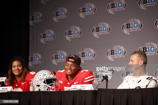 Big Ten Championship Ohio State coach Urban Meyer with QB Dwayne Hasking and Chase Young during press conference after game vs Northwestern at Lucas...