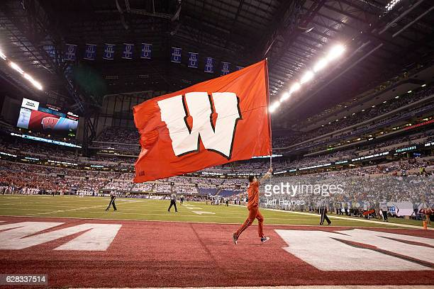 Big Ten Championship Wisconsin cheerleader on field with W flag during game vs Penn State at Lucas Oil Stadium Indianapolis IN CREDIT Jeff Haynes