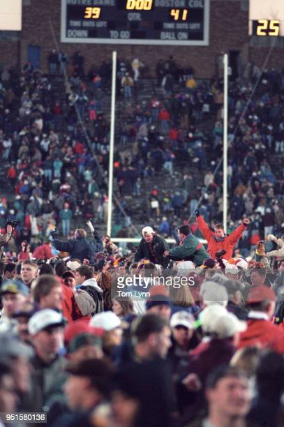 Boston College fans on field after winning game vs Notre dame at Nore Dame Stadium South Bend IN CREDIT Tom Lynn