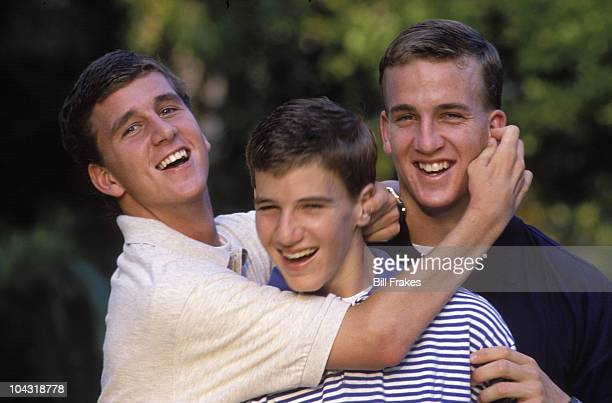 Casual portrait of Manning family brothers Cooper Manning Eli Manning and Tennessee QB Peyton Manning during photo shoot at their Garden District...