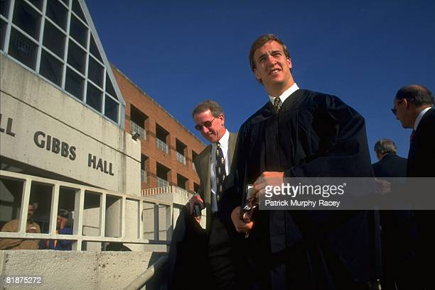 College Football Casual portrait of Tennessee QB Peyton Manning with father Archie at Gibbs Hall before commencement ceremony on University of...