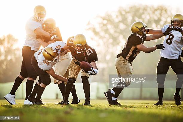 college football - catch and tackle. - tackling stock pictures, royalty-free photos & images