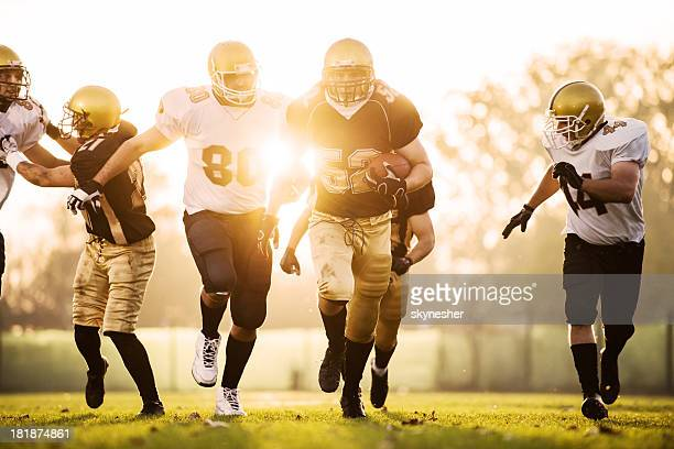 college football - catch and tackle. - wide receiver athlete stock pictures, royalty-free photos & images