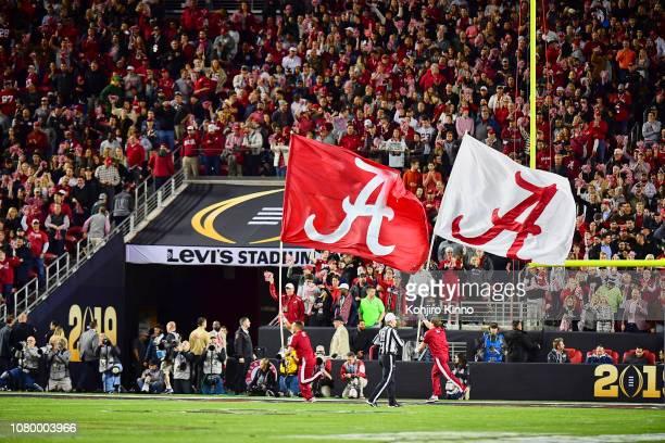 CFP National Championship Alabama cheerleaders running on field with flags during game vs Clemson at Levi's Stadium Santa Clara CA CREDIT Kohjiro...