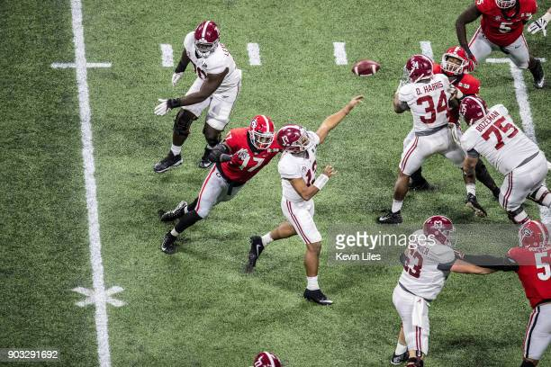 CFP National Championship Alabama QB Tua Tagovailoa in action making pass under pressure vs Georgia Davin Bellamy at MercedesBenz Stadium Atlanta GA...