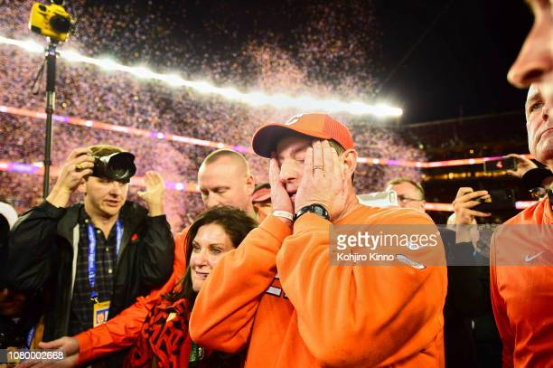 CFP National Championship Clemson coach Dabo Swinney victorious with wife Kathleen walking off field after winning game vs Alabama at Levi's Stadium...