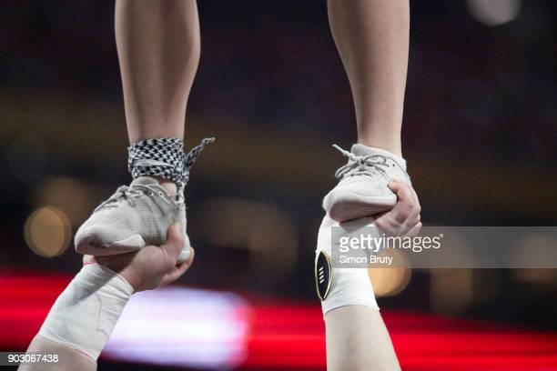 CFP National Championship Closeup of Alabama cheerleader's feet being help up by another cheerleader during game vs Georgia at MercedesBenz Stadium...