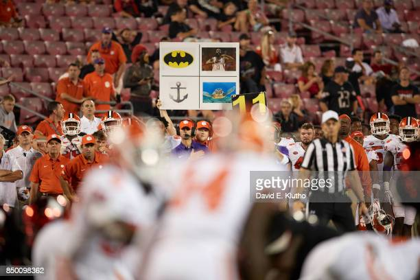 Clemson assistant holding up sign on sidelines during game vs Louisville at Papa John's Cardinal Stadium Louisville KY CREDIT David E Klutho