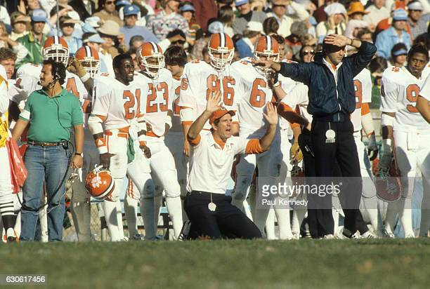 Clemson coach Danny Ford down on his knees on sidelines during game vs North Carolina at Kenan Memorial Stadium Chapel Hill NC CREDIT Paul Kennedy