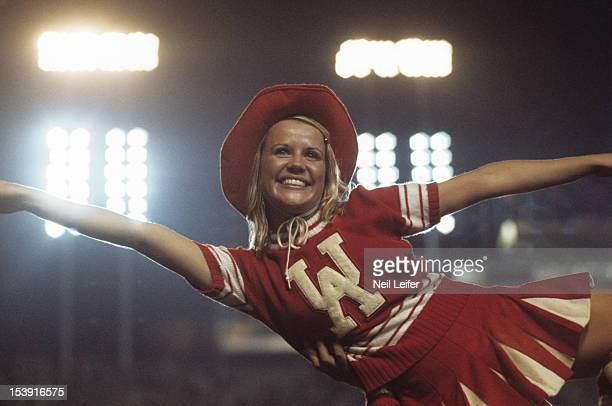 Closeup of Alabama cheerleader in action during game vs Louisiana State at LSU Tiger Stadium Baton Rouge LA CREDIT Neil Leifer Set Number X18189