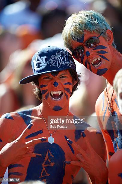 Closeup of Auburn painted fans in stands during game vs LSU Auburn AL CREDIT Bob Rosato
