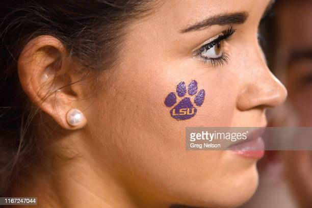Closeup of LSU cheerleader with temporary tattoo on face of a tiger paw print before game vs Texas at Darrell K Royal Texas Memorial Stadium Austin...