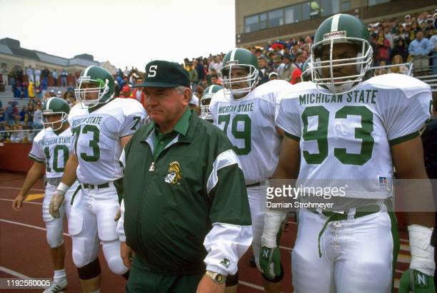 Closeup of Michigan State head coach George Perles on field with team before game vs Boston College at Alumni Stadium Boston MA CREDIT Damian...