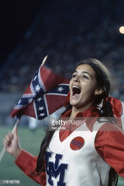 Closeup of Mississippi cheerleader with Confederate flag during game vs Alabama at Mississippi Veterans Memorial Stadium Jackson MS CREDIT Neil Leifer
