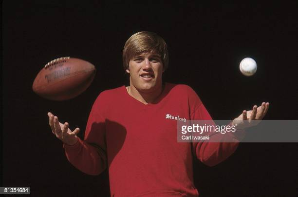 College Football Closeup portrait of Stanford QB John Elway with football and baseball equipment San Jose CA 4/1/1983