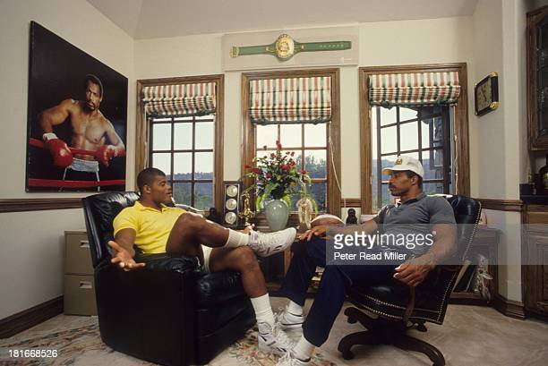 Closeup portrait of UCLA linebacker Ken Norton Jr with his father former heavyweight champion Ken Norton Sr during photo shoot at home Laguna Niguel...