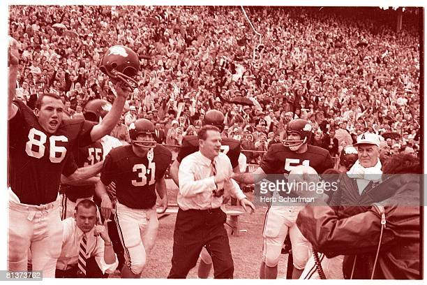 College Football Cotton Bowl Arkansas coach Frank Broyles victorious with team after winning game and completing perfect season vs Nebraska Dallas TX...