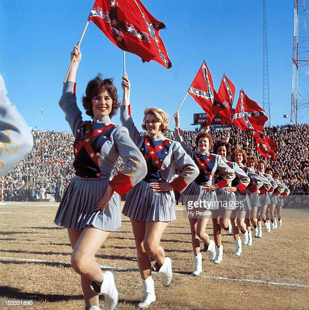 Cotton Bowl Mississippi cheerleaders Jeffry Whitaker Dottie Butler Glynn McPherson Melinda Stewart and Linda White in action with Confederate flags...