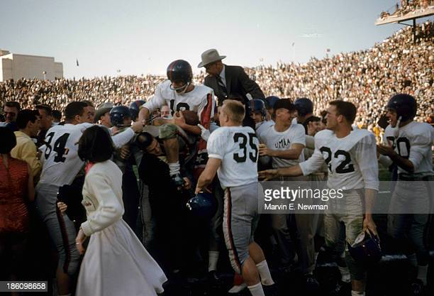 Cotton Bowl Mississippi QB Eagle Day with coach Johnny Vaught victorious being carried off field after winning game vs Texas Christian at Cotton Bowl...