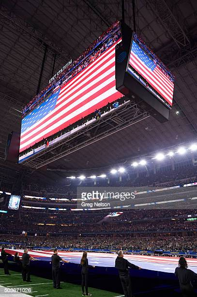 Cotton Bowl: View of USA flag unfurled on field during anthem before Alabama vs Michigan State game during College Football Playoff Semifinal at AT&T...