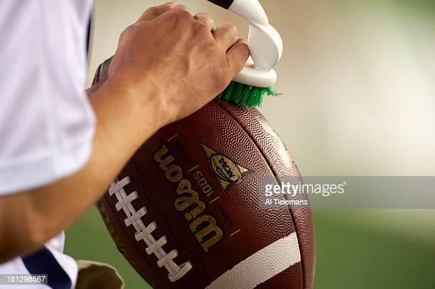 Cowboys Classic Closeup view of ball being scruffed before Michigan vs Alabama game at Cowboys Stadium Equipment Arlington TX CREDIT Al Tielemans