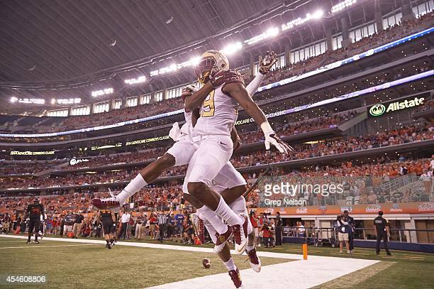 Cowboys Classic Florida State Nate Andrews victorious after returning interception for touchdown vs Oklahoma State at ATT Stadium Arlington TX CREDIT...