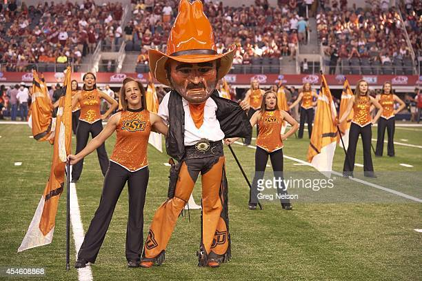 Cowboys Classic Oklahoma State mascot Pistol Pete with cheerleaders on field during game vs Florida State at ATT Stadium Arlington TX CREDIT Greg...
