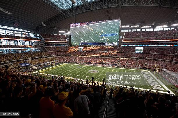 Cowboys Classic Overall view of Michigan Matt Wile in action kicking off vs Alabama at Cowboys Stadium Arlington TX CREDIT David E Klutho
