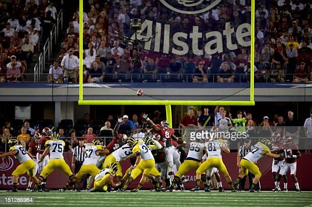 Cowboys Classic Rear view of Michigan Brendan Gibbons in action kicking vs Alabama at Cowboys Stadium Arlington TX CREDIT David E Klutho