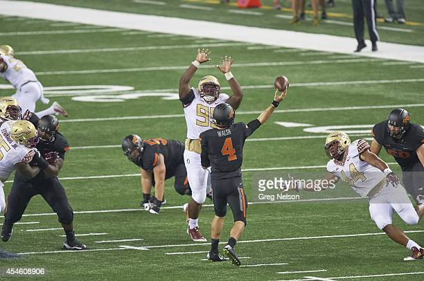 Cowboys Classic Rear view of Oklahoma State QB JW Walsh in action passing vs Florida State Keith Bryant at ATT Stadium Arlington TX CREDIT Greg Nelson