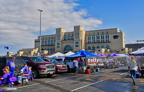 College football fans tailgate outside Bill Snyder Family Football Stadium, before a game between the Kansas State Wildcats and Baylor Bears on...