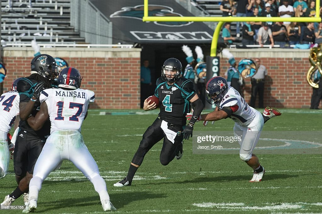 Coastal carolina university vs university of richmond pictures coastal carolina qb austin brown 4 in action rushing vs richmond at brooks sciox Gallery