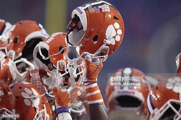 Fiesta Bowl Closeup view of Clemson helmets raised victoriously after winning game vs Ohio State at University of Phoenix Stadium Phoenix AZ CREDIT...