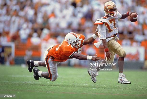 Florida State QB Charlie Ward in action under pressure vs Miami Warren Sapp Miami FL 10/3/1992 CREDIT Damian Strohmeyer