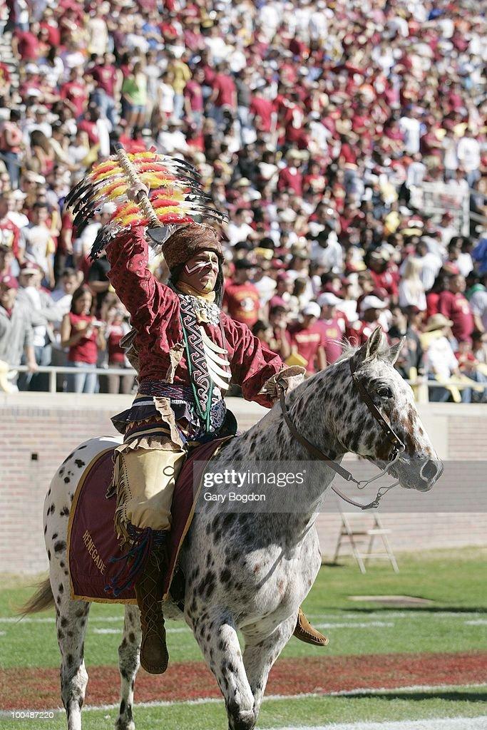 Florida State Seminoles mascot Chief Osceola aboard horse Renegade before game vs Florida. Tallahassee, FL