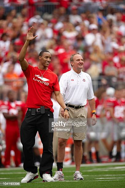 Former Ohio State basketball player Evan Turner with coach Thad Matta on field before game vs Miami Columbus OH 9/11/2010 CREDIT Al Tielemans