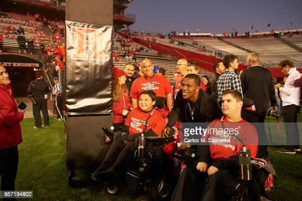 Former Rutgers players Ray Rice posing for picture with young fans on field before game vs Ohio State at High Point Solutions Stadium New Brunswick...