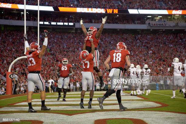 Georgia Davin Bellamy victorious with Nick Chubb during game vs Mississippi State at Sanford Stadium Athens GA CREDIT Kevin Liles