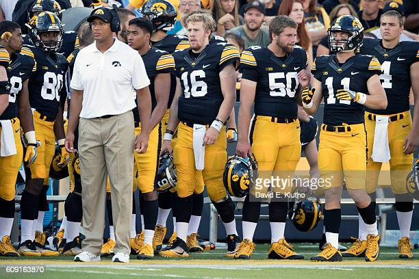 Iowa QB CJ Beathard Jackson Subbert and Ryan Boyle on sidelines during game vs Miami at Kinnick Stadium Iowa City IA CREDIT David E Klutho