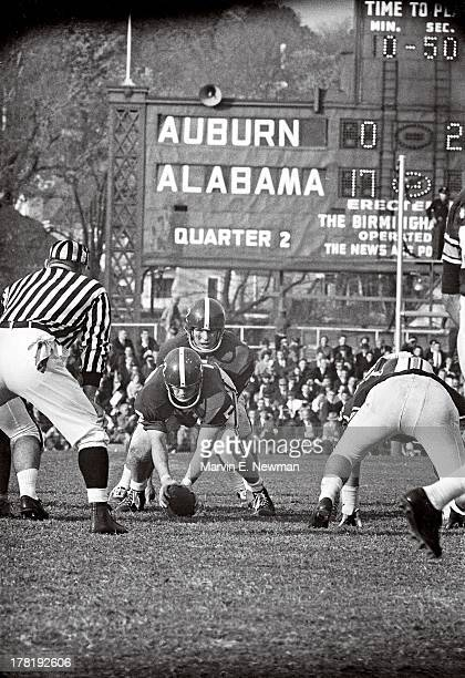 Iron Bowl Alabama QB Pat Trammell at line of scrimmage during game vs Auburn at Legion Field View of scoreboard in background Birmingham AL CREDIT...