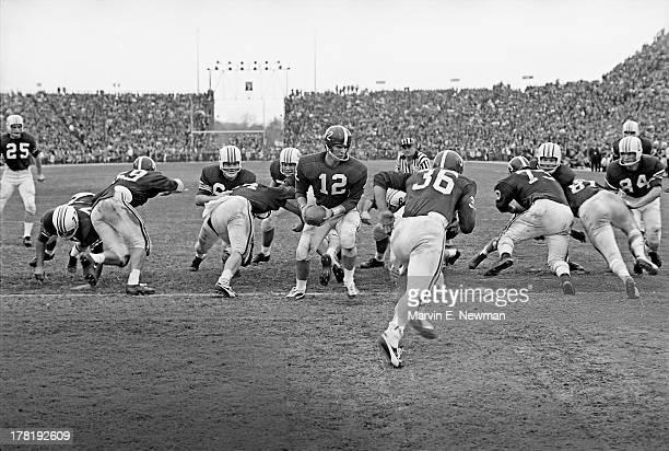 Iron Bowl Alabama QB Pat Trammell in action handoff to Larry Wall vs Auburn at Legion Field Birmingham AL CREDIT Marvin E Newman