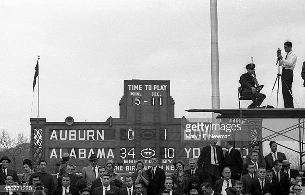 Iron Bowl View of fans on sidelines during Alabama vs Auburn game at Legion Field View of scoreboard in background Birmingham AL CREDIT Marvin E...
