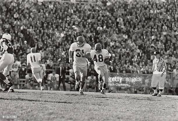 College Football Kansas Gale Sayers in action rushing with blocking teammate Ken Coleman during game vs Nebraska Lincoln NE 11/9/1963