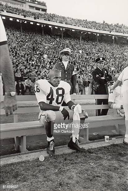 College Football Kansas Gale Sayers on sidelines bench during game vs Nebraska Lincoln NE 11/9/1963