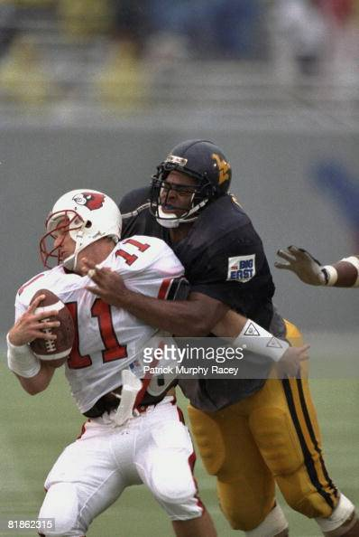 Louisville QB Jeff Brohm in action during sack vs West ...